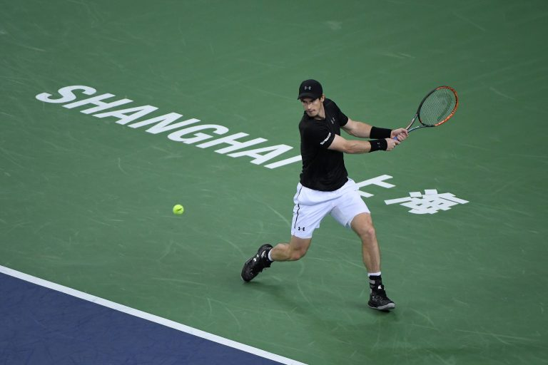 Andy Murray hits a return in the Shanghai Masters tennis tournament